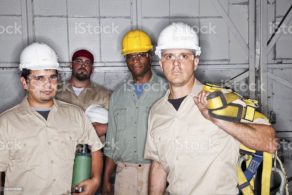 Team of manual workers stock photo