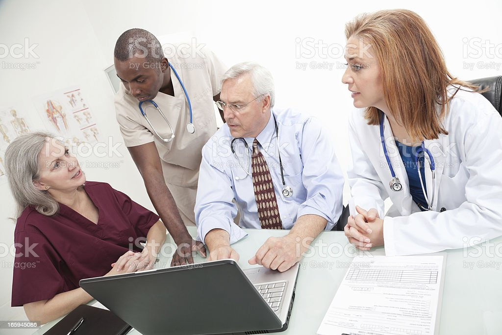 Team of Medical Personnel Discussing Things royalty-free stock photo