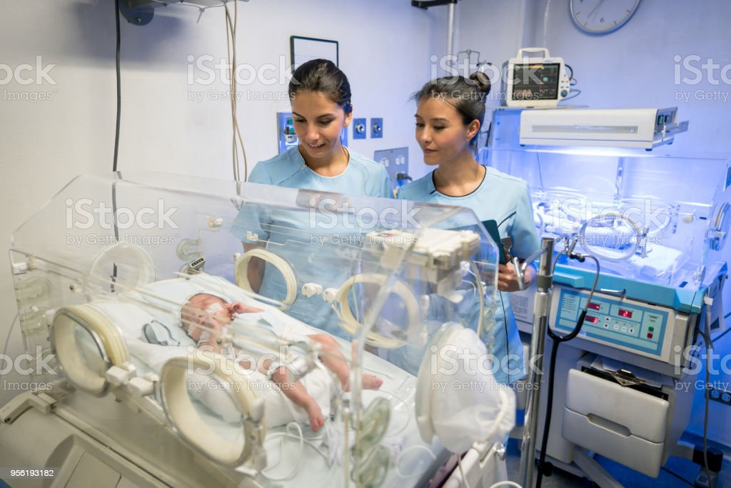 Team Of Nurses Checking The Babies In Incubators At The Neonatal