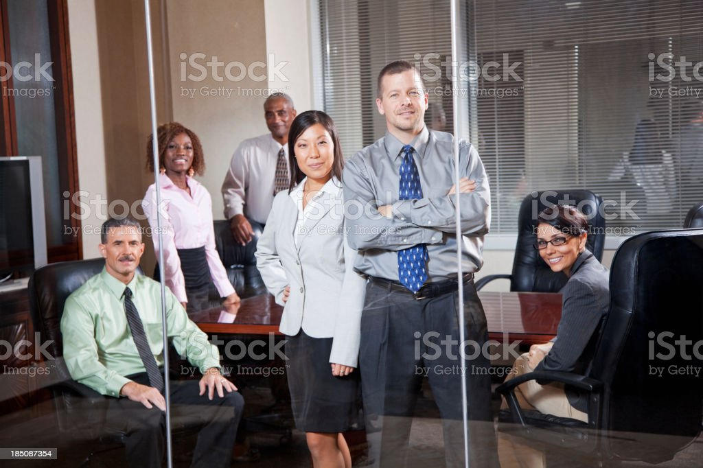 Team of office workers in boardroom stock photo