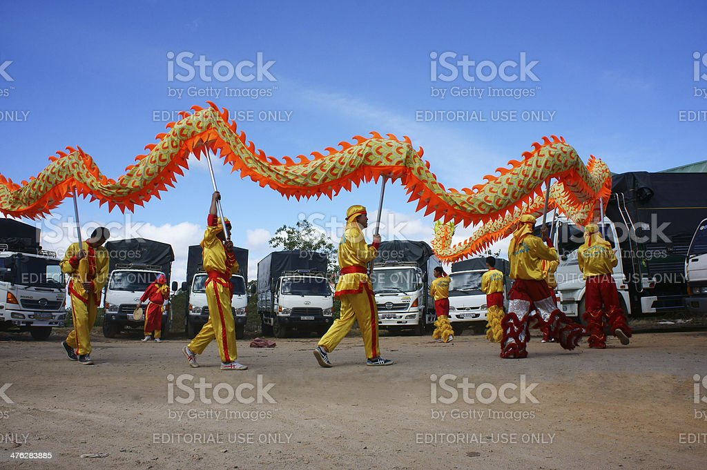 Team of people perform dragon dance royalty-free stock photo