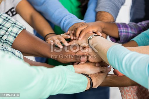 istock Team of people with hands together 623503414