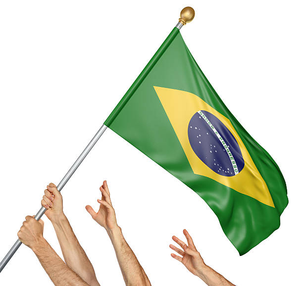 Team of peoples hands raising the Brazil national flag stock photo