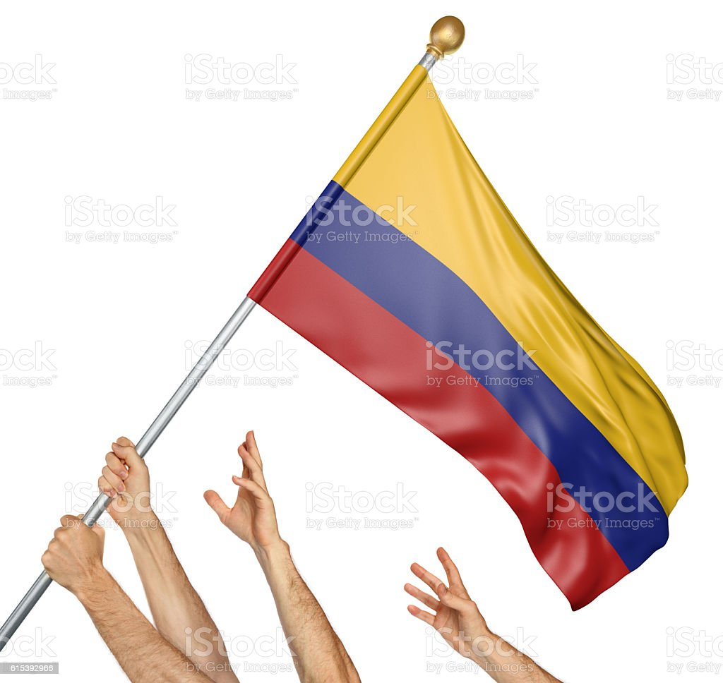 Team of peoples hands raising the Colombia national flag stock photo