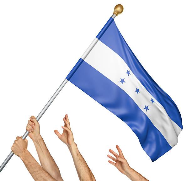 team of peoples hands raising the honduras national flag - bandera de honduras fotografías e imágenes de stock