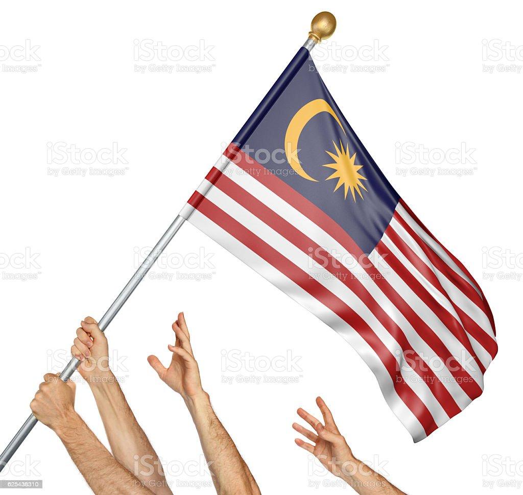 Team of peoples hands raising the Malaysia national flag - foto de acervo
