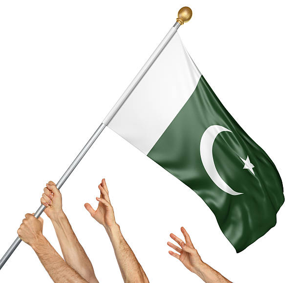 team of peoples hands raising the pakistan national flag - pakistani flag stock photos and pictures
