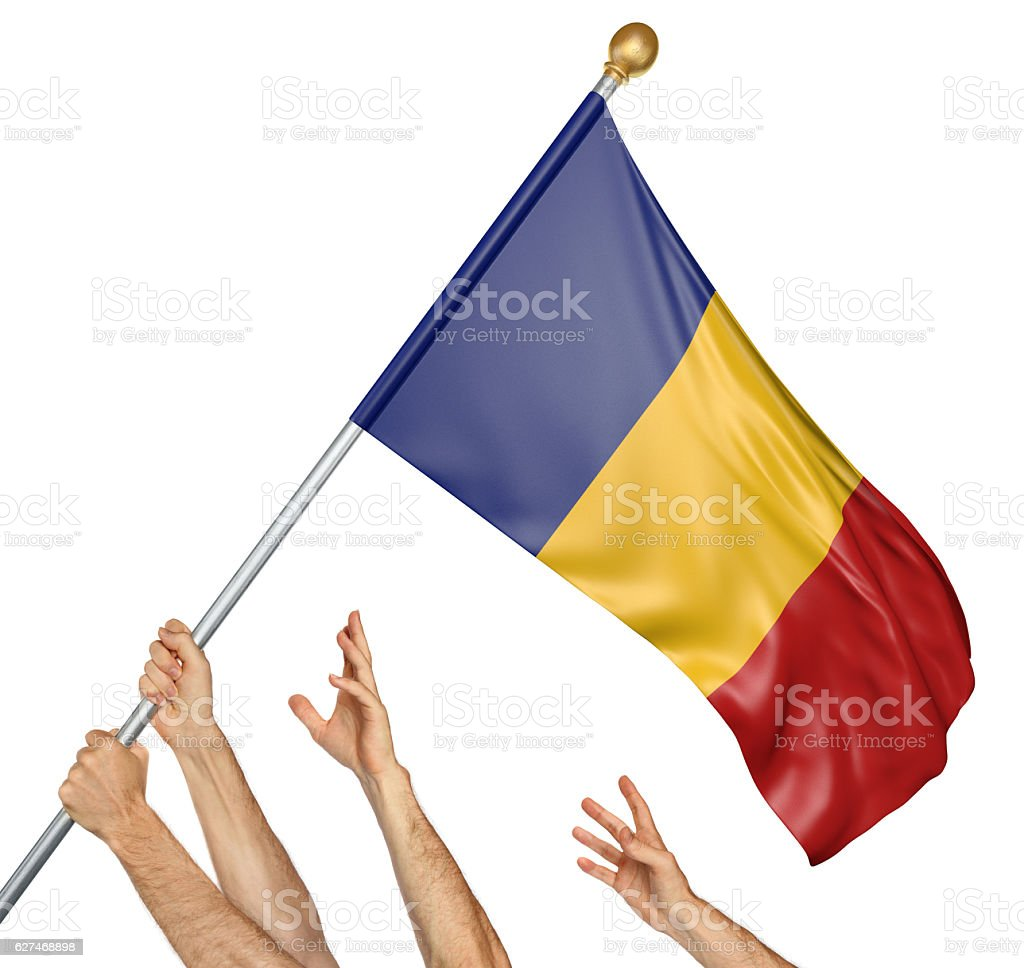 Team of peoples hands raising the Romania national flag stock photo