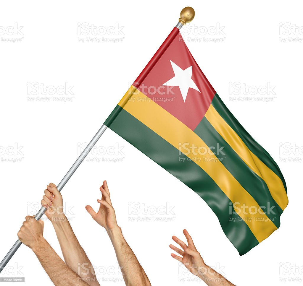 Team of peoples hands raising the Togo national flag stock photo