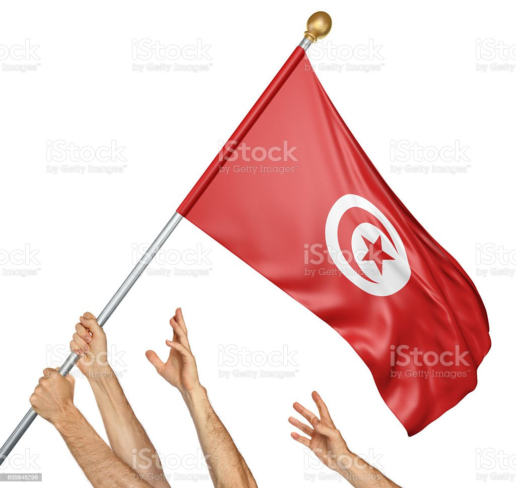 Team of peoples hands raising the Tunisia national flag stock photo