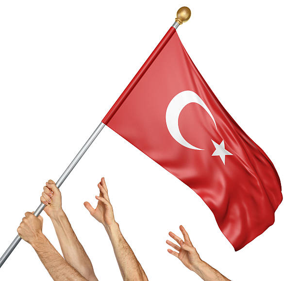 Team of peoples hands raising the Turkey national flag stock photo