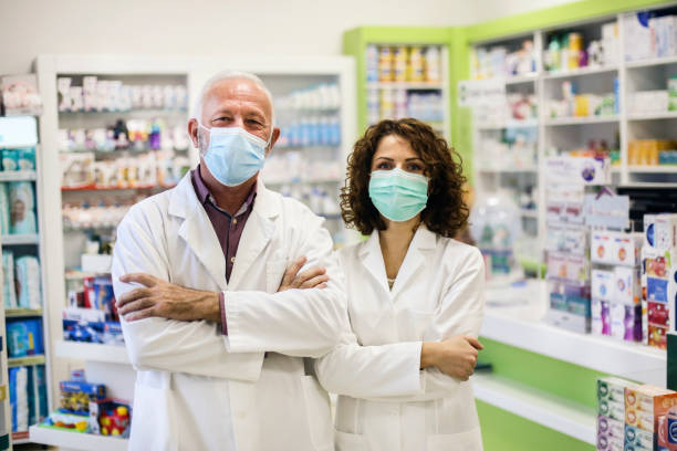 Team of pharmacists during the pandemic stock photo
