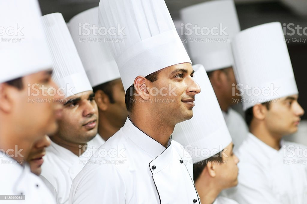 Team of professional chefs royalty-free stock photo