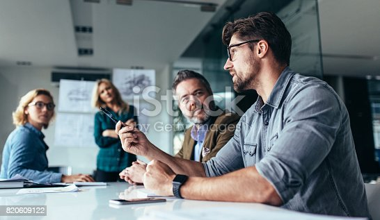 istock Team of professionals discussing over new business project 820609122