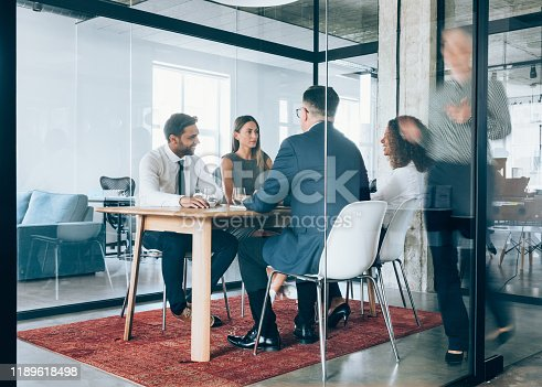 1163429625istockphoto Team of professionals during a meeting. 1189618498