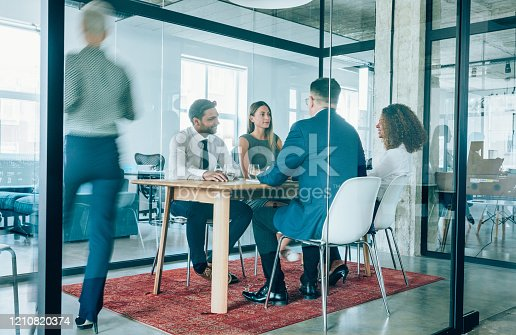 1163429625istockphoto Team of professionals during a meeting. 1210820374