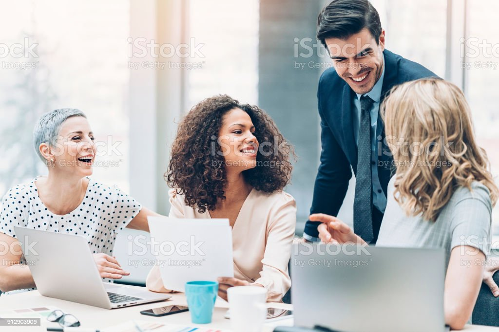 Team of professionals in discussion stock photo