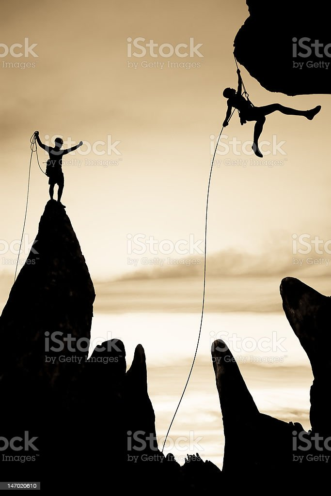 Team of rock climbers on the summit. royalty-free stock photo
