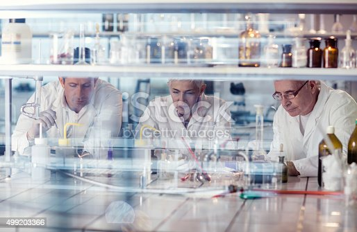 istock Team of scientists working on new scientific research in laboratory. 499203366