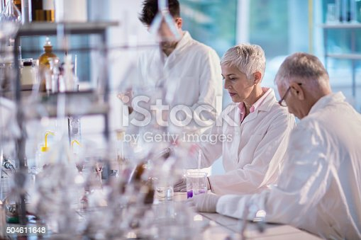499203366istockphoto Team of scientists working on new scientific research in laboratory. 504611648
