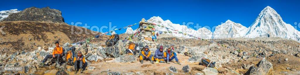 Team of Sherpa mountaineers resting below Everest Himalayas panorama Nepal stock photo