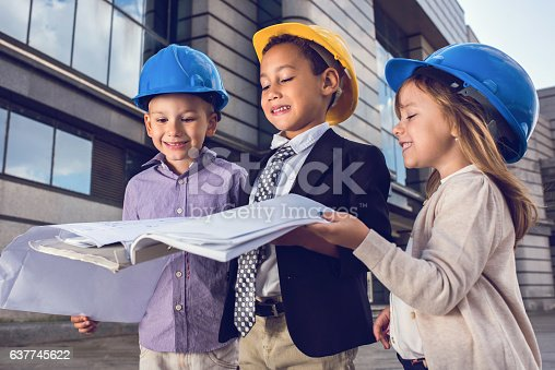 643843490istockphoto Team of small building contractors looking at blueprints outdoors. 637745622