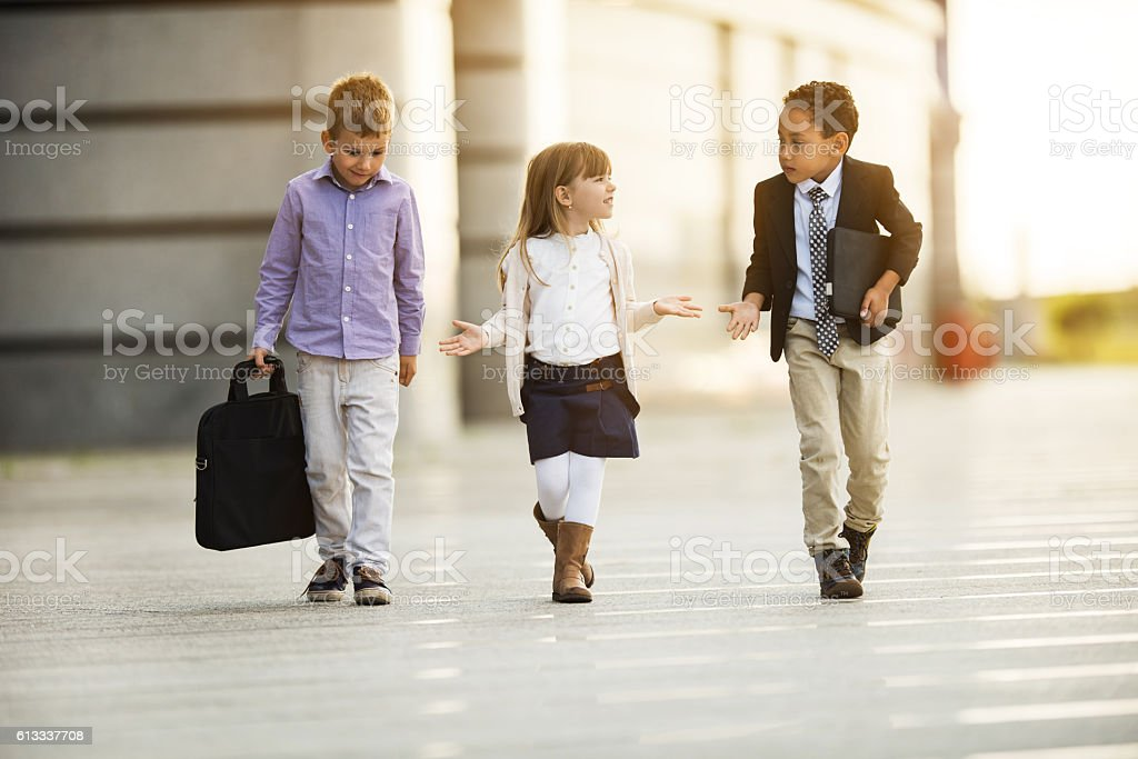 Team of small business people walking and communicating. stock photo
