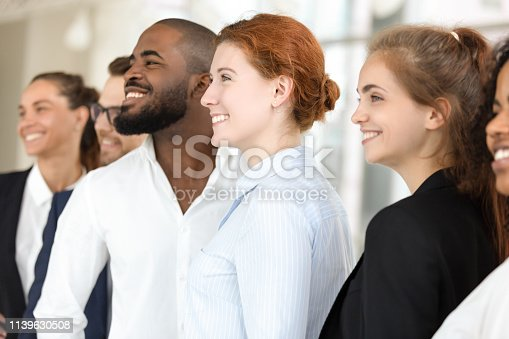 istock Team of smiling diverse office workers posing for photo indoors 1139630508
