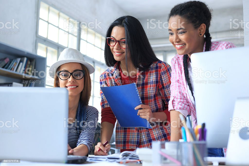 Team of smiling young people working at the office royalty-free stock photo