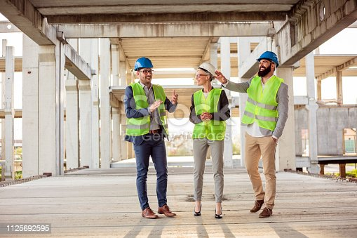 1166176793 istock photo Team of successful architects checking work progress on a construction site 1125692595
