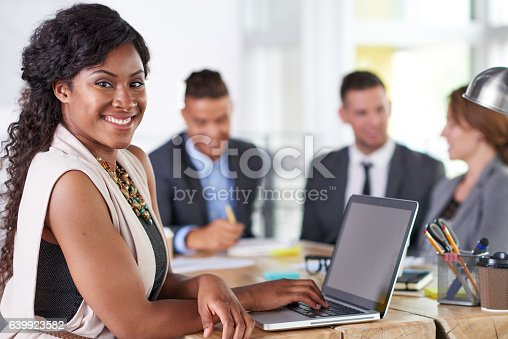 istock team of successful business people having a meeting in executive 639923582