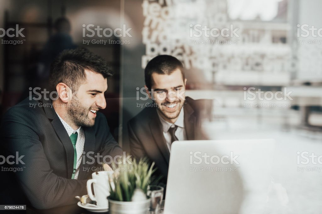 Team of successful business people having a meeting in the cafeteria royalty-free stock photo