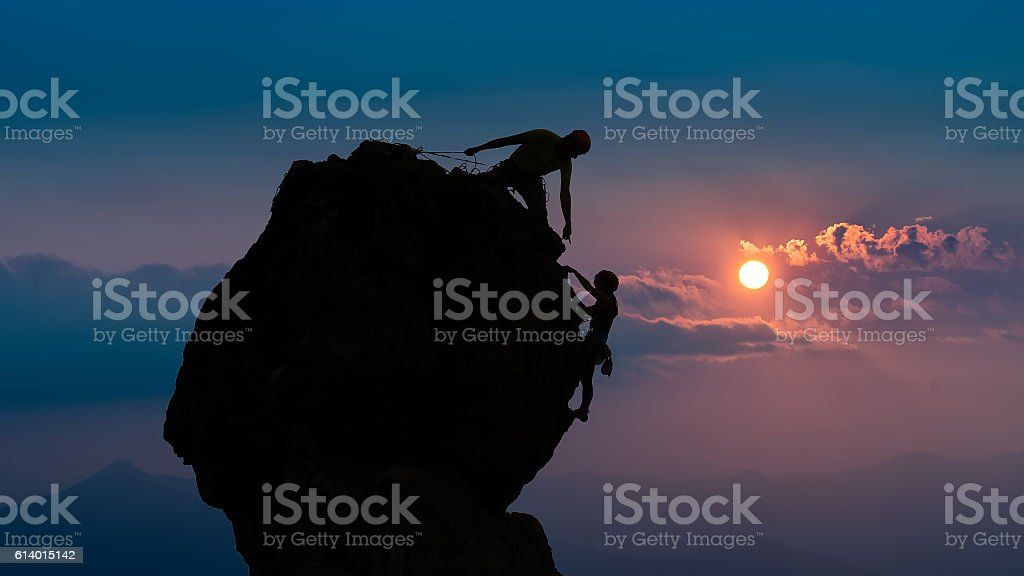 Team of two mountaineers stock photo