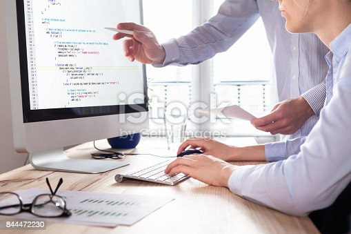 istock Team of web app developers coding website source code, debugging 844472230
