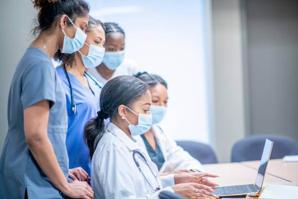 Team of woman medical professionals working together stock photo
