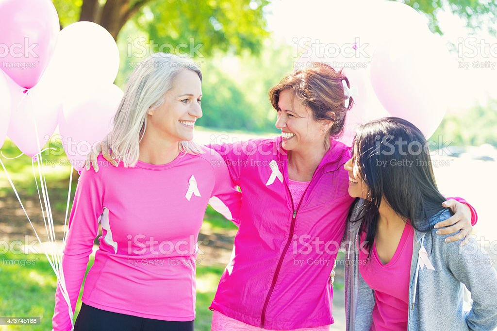 Team of women at breast cancer survivor race for charity stock photo