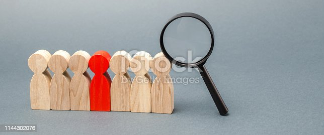 istock Team of workers and magnifying glass. Search for people. Attraction to work. Human Resource Management. Hiring. Promotion. Talented worker. Working staff. Employee. Recruiting. Hire. Hr 1144302076