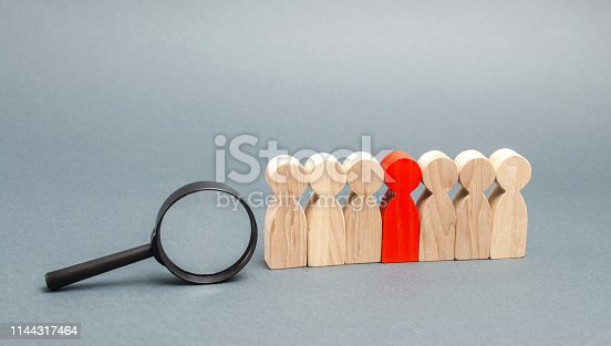 istock Team of workers and magnifying glass. Search for people. Attraction to work. Human Resource Management. Hiring. Promotion. Talented worker. Working staff. Employee. Recruiting. Hire. Hr 1144317464
