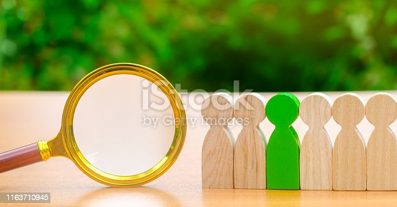 istock Team of workers and magnifying glass. Search for people. Attraction to work. Human Resource Management. Hiring. Promotion. Talented worker. Working staff. Employee. Recruiting. Hire. Hr 1163710945