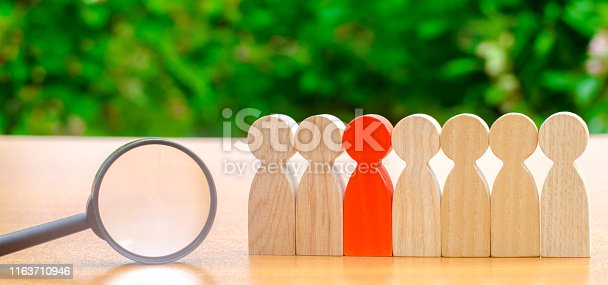 istock Team of workers and magnifying glass. Search for people. Attraction to work. Human Resource Management. Hiring. Promotion. Talented worker. Working staff. Employee. Recruiting. Hire. Hr 1163710946