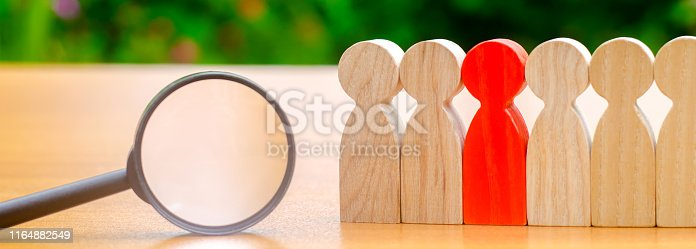 istock Team of workers and magnifying glass. Search for people. Attraction to work. Human Resource Management. Hiring. Promotion. Talented worker. Working staff. Employee. Recruiting. Hire. Hr 1164882549