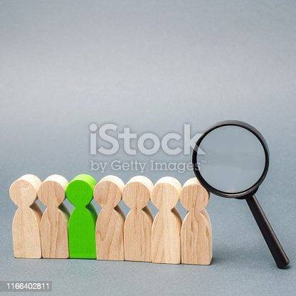 istock Team of workers and magnifying glass. Search for people. Attraction to work. Human Resource Management. Hiring. Promotion. Talented worker. Working staff. Employee. Recruiting. Hire. Hr 1166402811