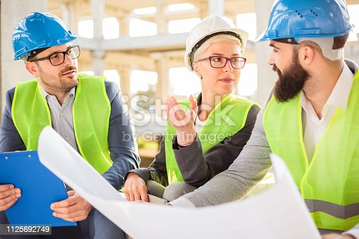 1166176793 istock photo Team of young architects and business partners meeting on a construction site 1125692749