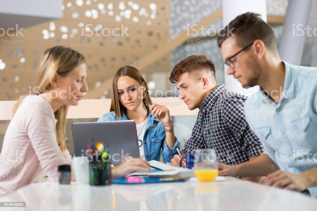 Team of young  business people in the office stock photo
