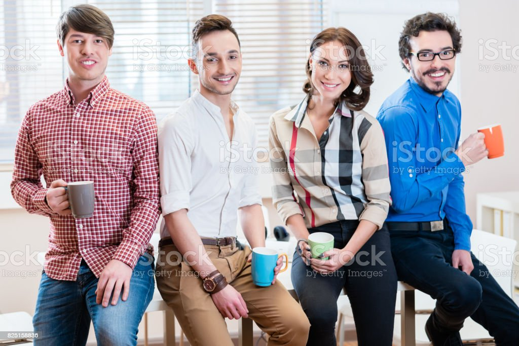 Team of young creative business people in office stock photo