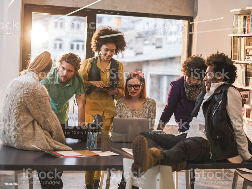 Team of young creative people brainstorming on a meeting. royalty-free stock photo