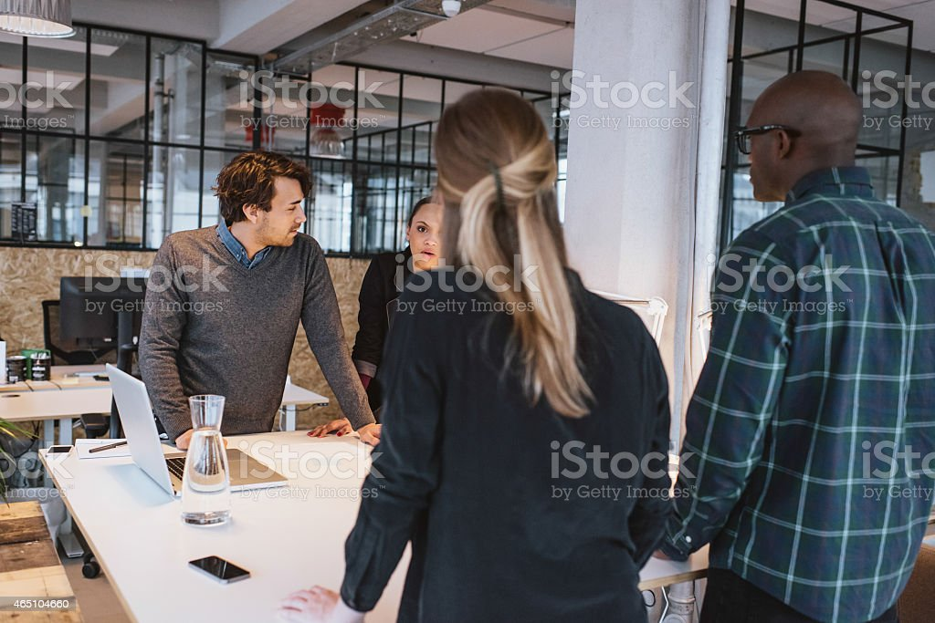 Team of young designers working together in office stock photo