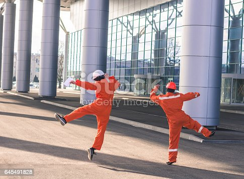 istock team of  young engineers happy jumping after heavy work. 645491828