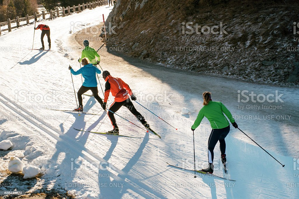 Team of young people cross country skiing stock photo