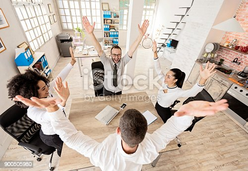 1016771914 istock photo Team of young people holding hands, high angle view 900505980